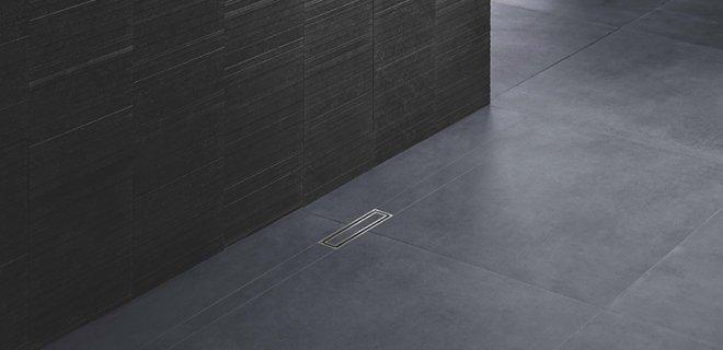 Voor een stijlvolle douchevloer: betegel de douchevloergoot
