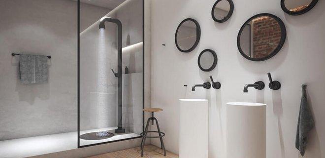 Zwarte kranen en douches met industriële uitstraling