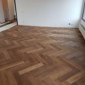 Eiken houten vloer visgraat | De Haan Natuursteen