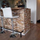Keukenbar met teakhouten strips | Woodindustries