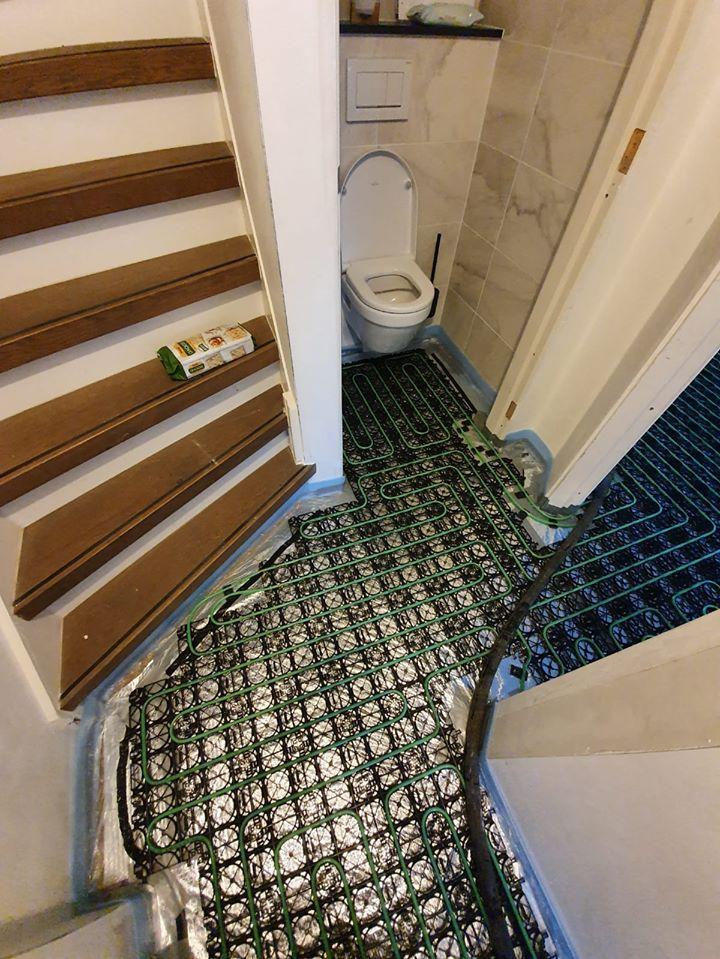 Verwarmde toiletvloer | WARP systems