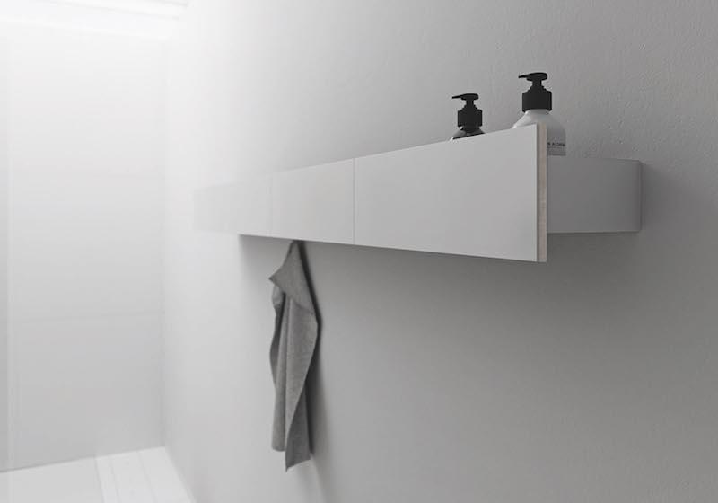 Sphinx Acanto hangend aflegschap met een verhoogd front oogt als een zwevend object. Ook als handdoekhouder met optioneel te bestellen haak #badkamerserie #badkamermeubel #sphinx