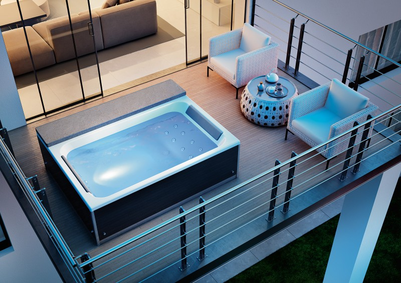 Whirlpool en massagebad met kleurentherapie - Magic Spa van Kinedo op terras