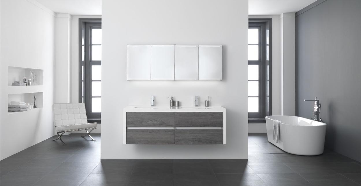 Thebalux badkamermeubel You. De wastafel loopt door over de zijkant van het meubel. In verschillende houtkleuren.