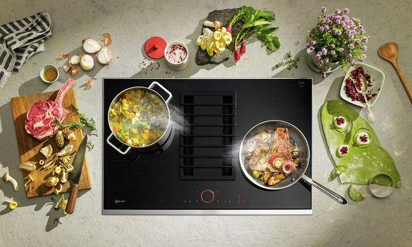 Flexibele inductiekookplaat met kookafzuiging van Neff. #koken #flexinductie #inductie #inductiekoken #keuken #kookplaat #neff