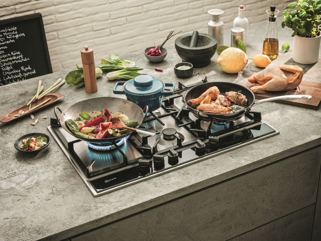 Perfect kkoken met de nieuwe gaskookplaten met de 9 niveau's van Flameselect van Neff