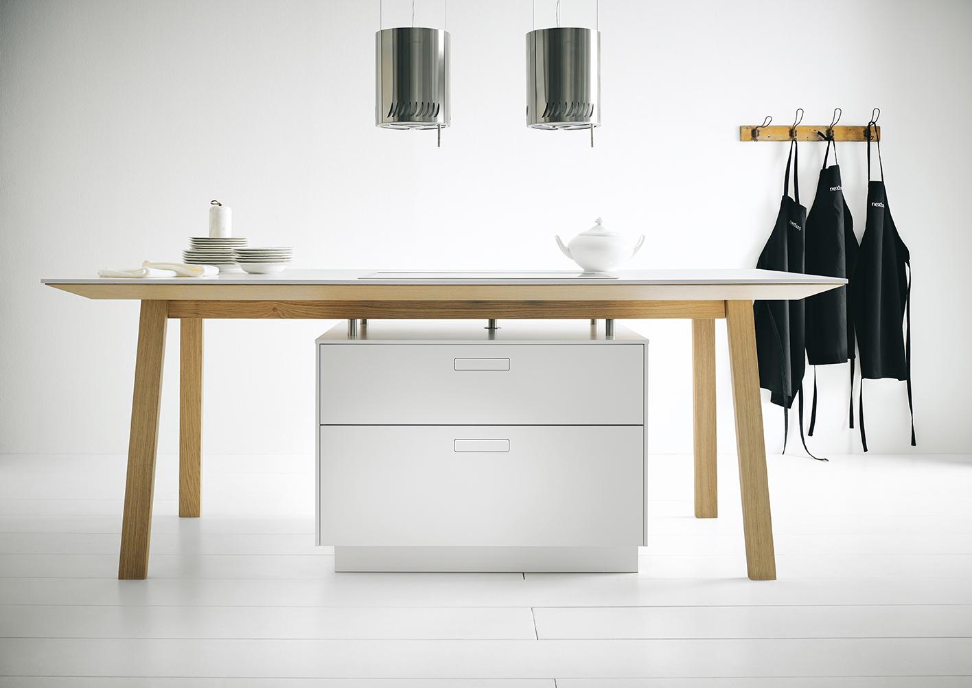 Witte kooktafel NX 800 van next125. Functioneel en uniek kookeiland. Een echte blikvanger in de keuken #next125 #kooktafel #kookeiland #inductie