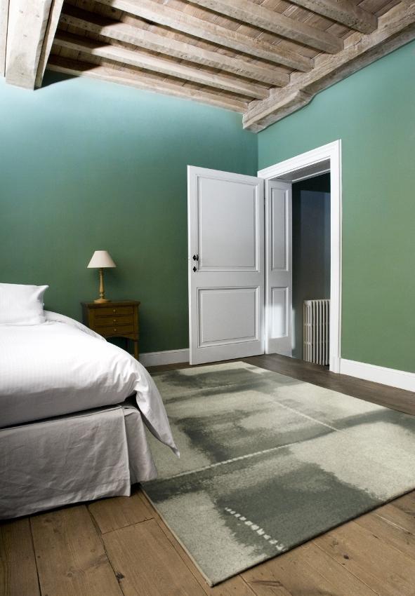 Slaapkamer met laminaat en vloerkleed via Carpetright